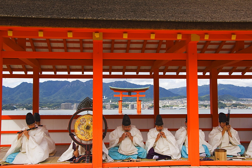 A Wedding Ceremony musical performance in front of the Floating Torii Gate at Itsukushima Shrine, founded in 593, UNESCO World Heritage Site, Miyajima Island, Hiroshima prefecture, Honshu Island, Japan, Asia - 733-2466