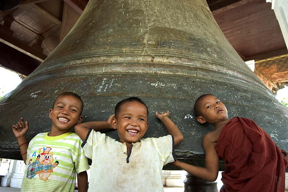 Young boys at Mingun Big Bell, Mingun, Mandalay district, Myanmar (Burma), Asia