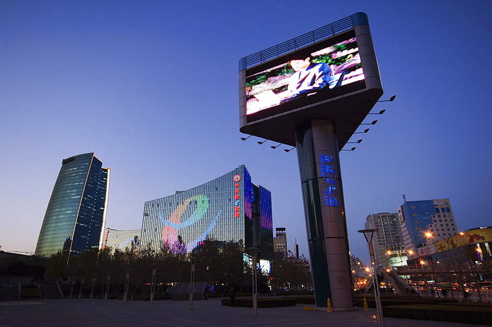 A giant television screen and The Sinosteel building in Zhongguancun Chinas biggest computer and electronic shopping center, Beijing, China, Asia