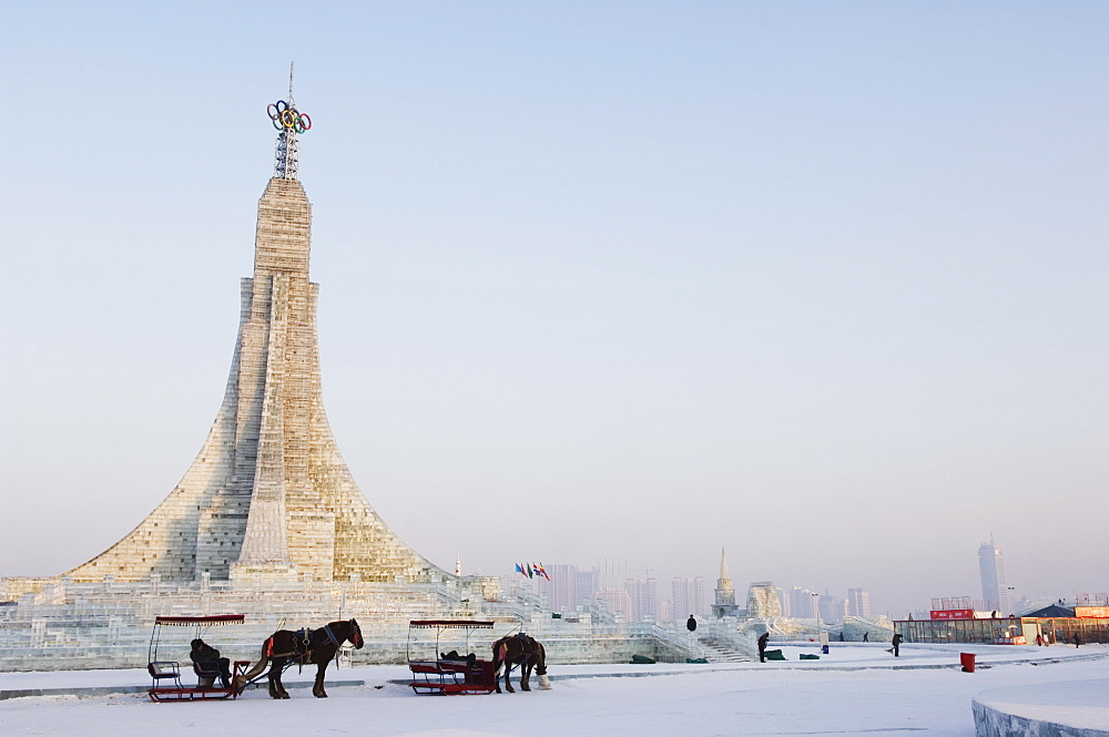 A horse and carriage and ice sculptures at the Ice Lantern Festival, Harbin, Heilongjiang Province, Northeast China, China, Asia - 733-2893
