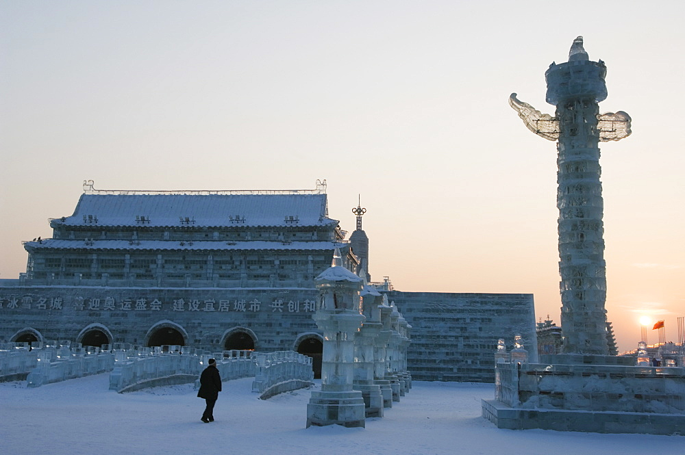 Sunset and replica Forbidden City ice sculpture at the Ice Lantern Festival, Harbin, Heilongjiang Province, Northeast China, China, Asia - 733-2899