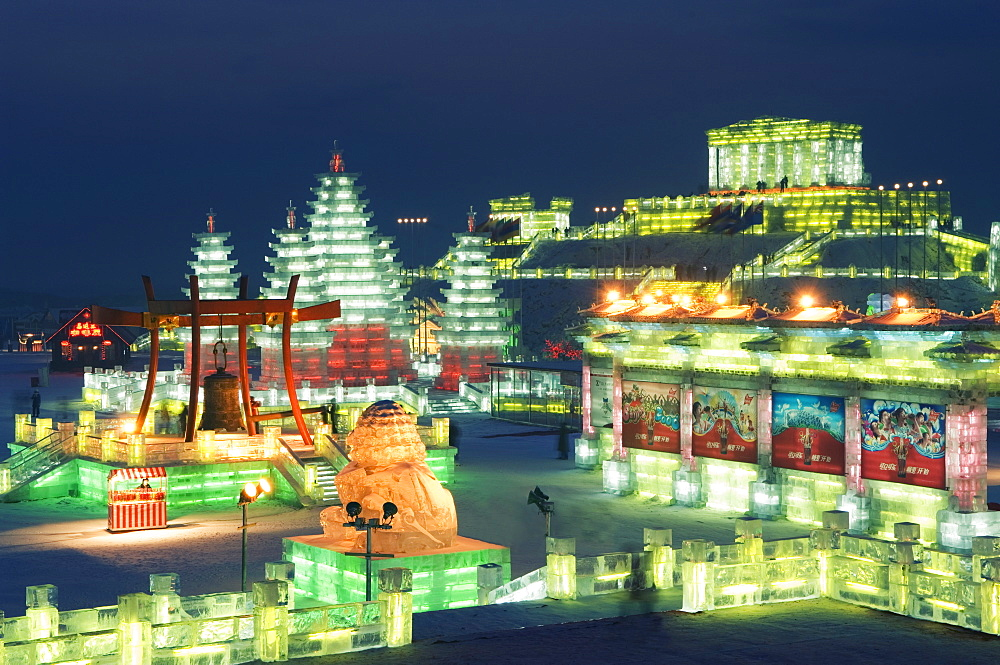 Snow and ice sculptures illuminated at night at the Ice Lantern Festival, Harbin, Heilongjiang Province, Northeast China, China, Asia - 733-2901