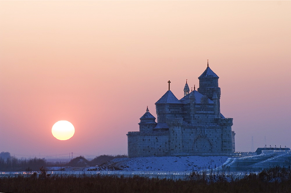 Sunset over an ice sculpture of a Russian orthodox church replica at the Ice Lantern Festival, Harbin, Heilongjiang Province, Northeast China, China, Asia - 733-2907