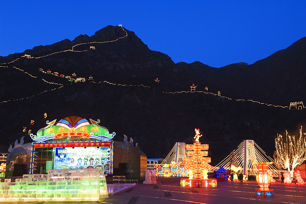 A display of night time illuminations and copy of the Great Wall of China at Longqing Gorge Ice sculpture festival, Beijing, China, Asia