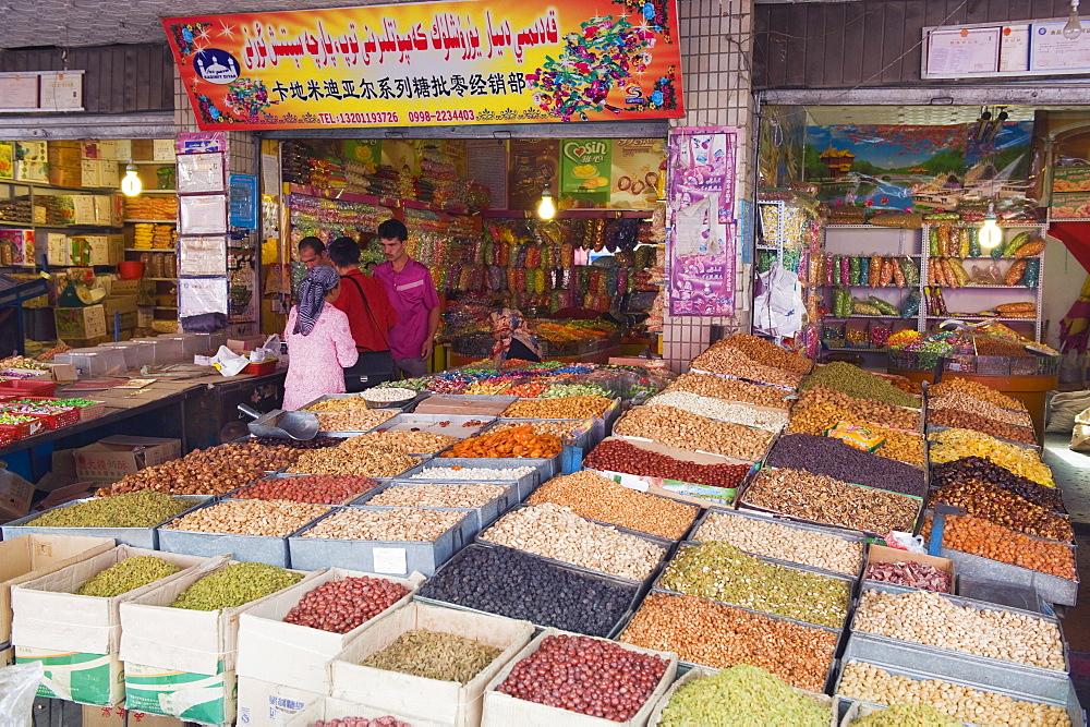 Dried fruit being sold at the Sunday market, Kashgar (Kashi) city, Xinjiang Provice, China, Asia