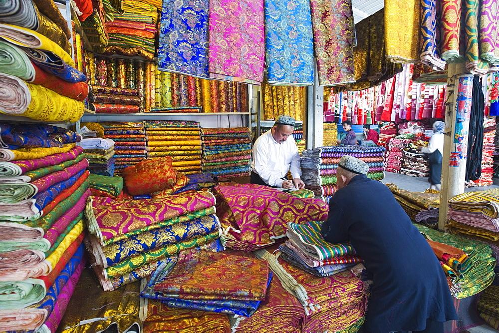 Silk fabrics being sold at the Sunday market, Kashgar (Kashi), Xinjiang Provice, China, Asia