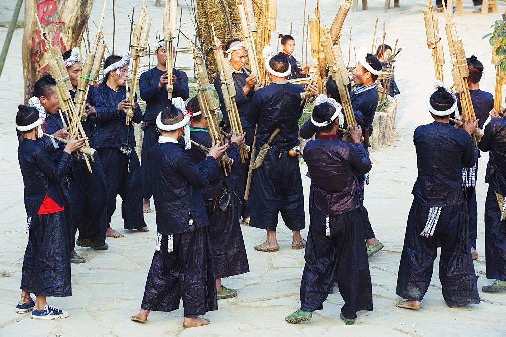 Miao ethnic minority group playing traditional musical bamboo instruments at Basha, Guizhou Province, China, Asia