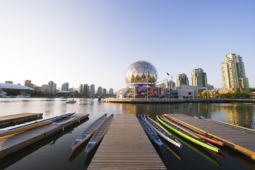 Colourful rowing boats in front of Telus Science World, on False Creek, Vancouver, British Columbia, Canada, North America