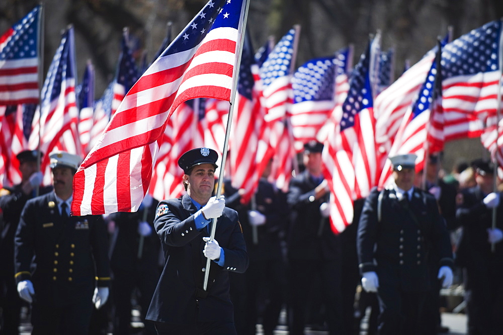 Police carrying American flags, St. Patricks Day celebrations in front of 5th Avenue, Manhattan, New York City, New York, United States of America, North America - 733-3510