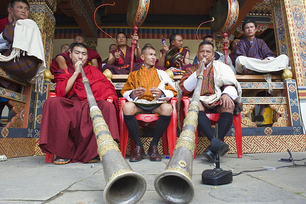 Monks playing horns and drums, Autumn Tsechu (festival) at Trashi Chhoe Dzong, Thimpu, Bhutan, Asia