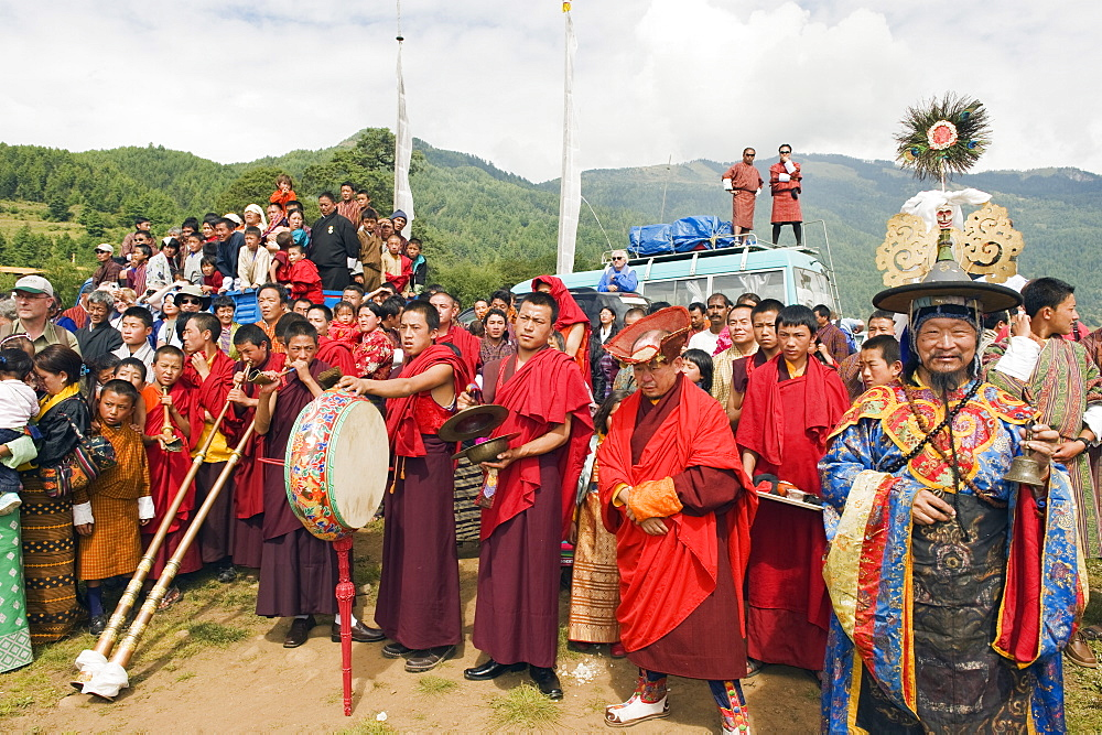 Monks and priest at Thangbi Mani Tsechu (festival), Jakar, Bumthang, Chokor Valley, Bhutan, Asia