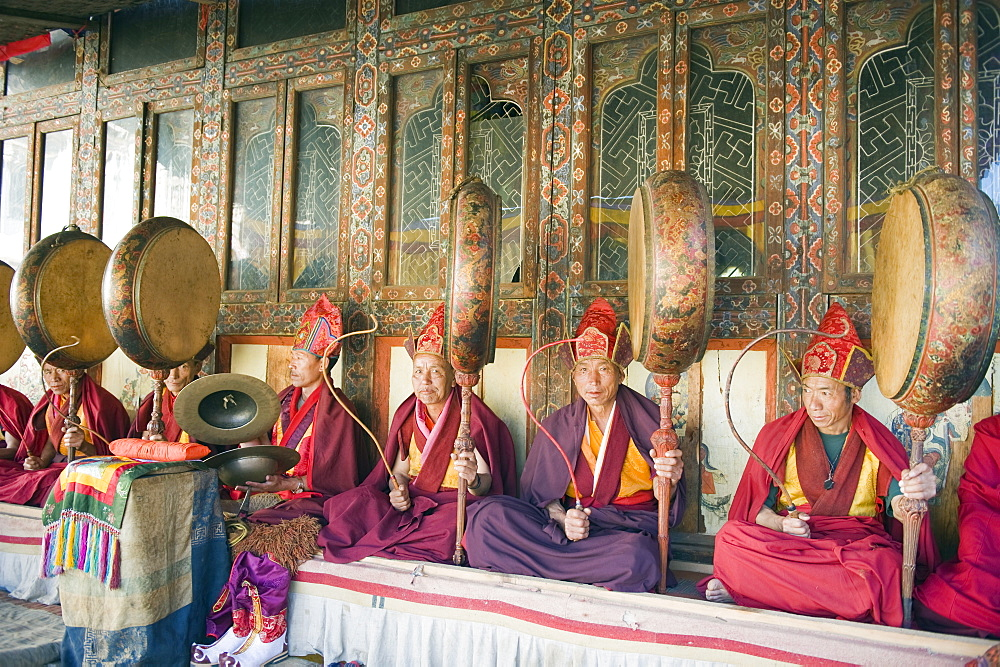 Monks playing drums at a Tsechu (festiva), Gangtey Gompa (Monastery), Phobjikha Valley, Bhutan, Asia
