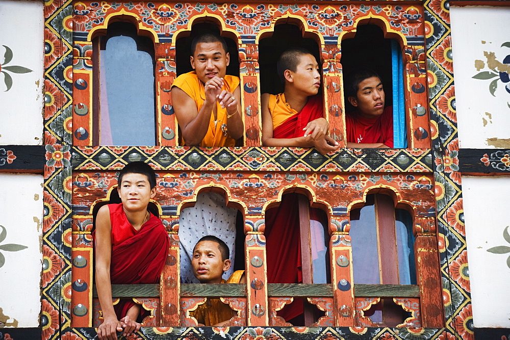 Young monks at a window, Chimi Lhakhang dating from 1499, Temple of the Divine Madman Lama Drukpa Kunley, Punakha, Bhutan, Asia - 733-3757