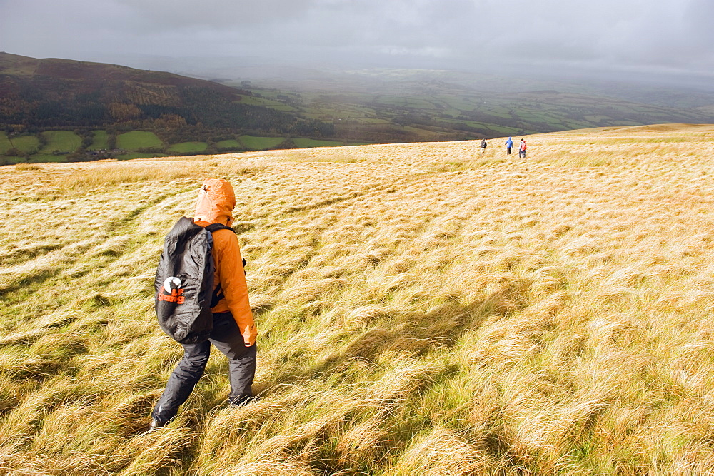 Hikers on Pen y Fan mountain, Brecon Beacons National Park, Powys, South Wales, United Kingdom, Europe