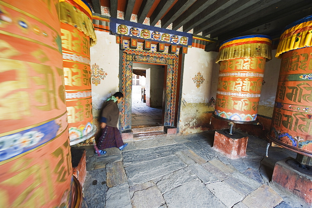 Woman spinning a prayer wheel, Jambay Lhakhang, built 659 by Tibetan King Songtsen Gampo, Jakar, Bumthang, Chokor Valley, Bhutan