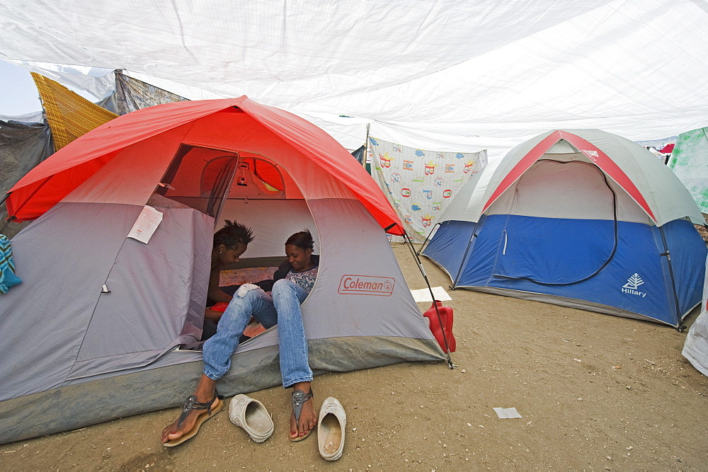 Homeless residents in a new tent city after the January 2010 earthquake, Port au Prince, Haiti, West Indies, Caribbean, Central America
