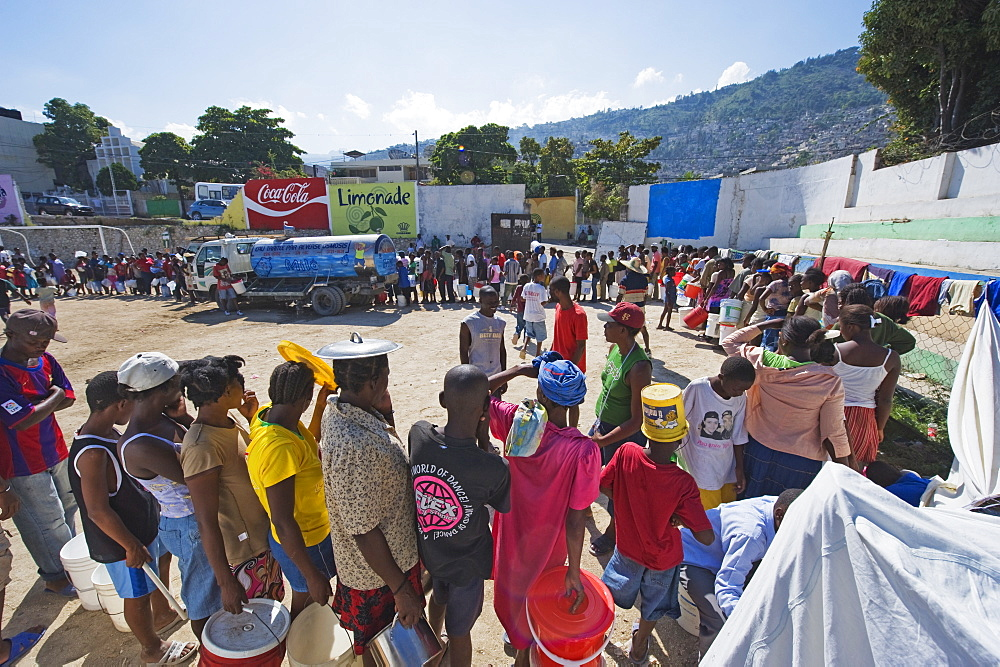 People lining up for water distribution after the January 2010 earthquake, Port au Prince, Haiti, West Indies, Caribbean, Central America