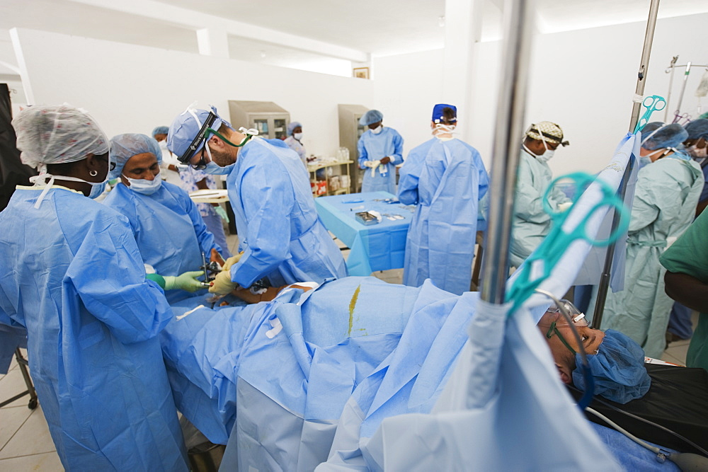 American doctor performing surgery, leg fracture patient, January 2010 earthquake, General Hospital, Port au Prince, Haiti, West Indies, Caribbean, Central America