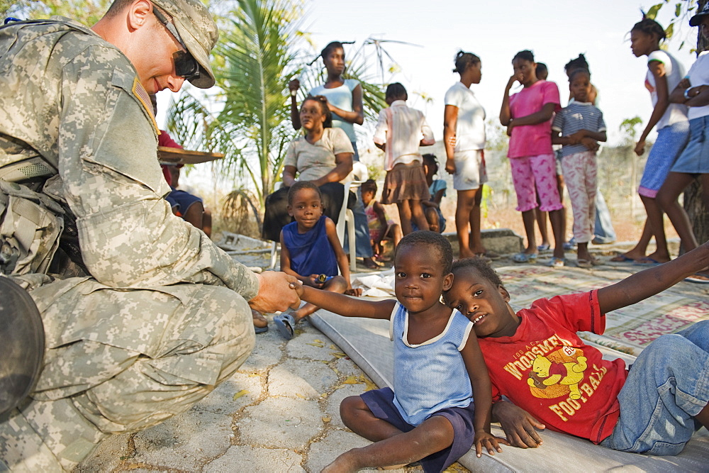 US Army soldier at an orphanage in Port au Prince after the 2010 earthquake, Port au Prince, Haiti, West Indies, Caribbean, Central America
