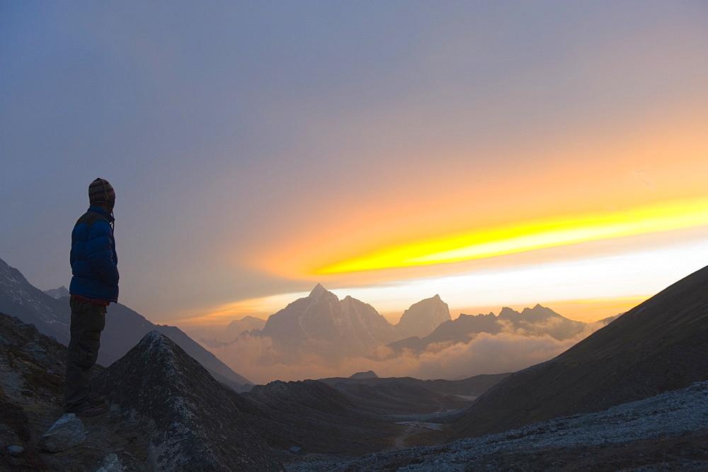 Trekker watching the sunset over Cholatse, 6335m, Solu Khumbu Everest Region, Sagarmatha National Park, Himalayas, Nepal, Asia - 733-4233