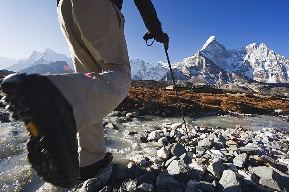 Trekker crossing a mountain stream, Ama Dablam, 6812m, Solu Khumbu Everest Region, Sagarmatha National Park, Himalayas, Nepal, Asia - 733-4243