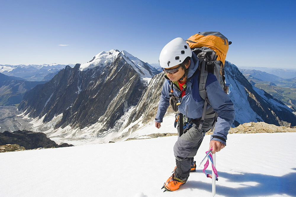 Climber on Aiguille de Bionnassay on the route to Mont Blanc, French Alps, France, Europe