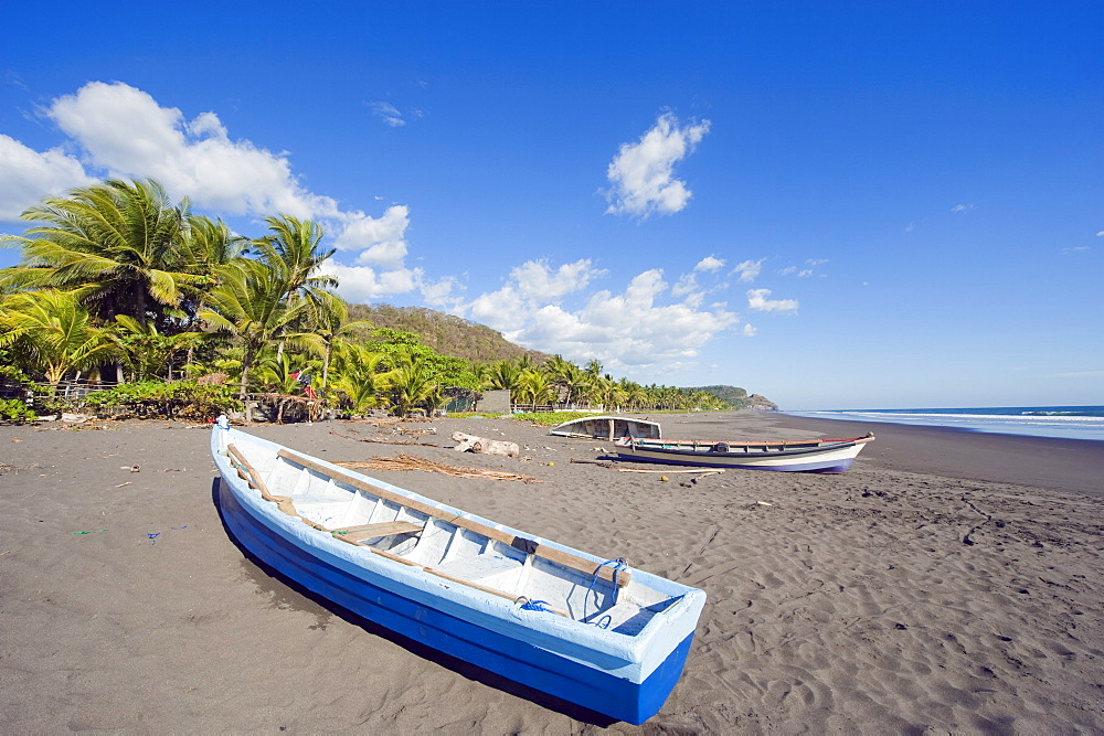 Fishing boats on the beach at Playa Sihuapilapa, Pacific Coast, El Salvador, Central America