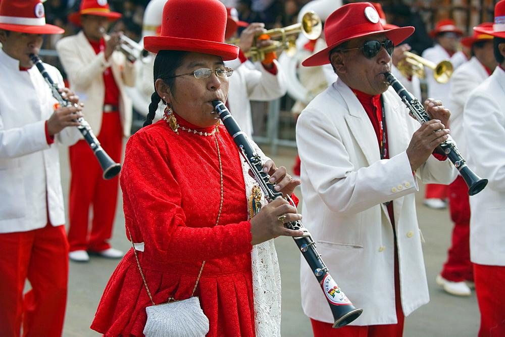 Musicians playing clarinet at Anata Andina harvest festival, Carnival, Oruro, Bolivia, South America