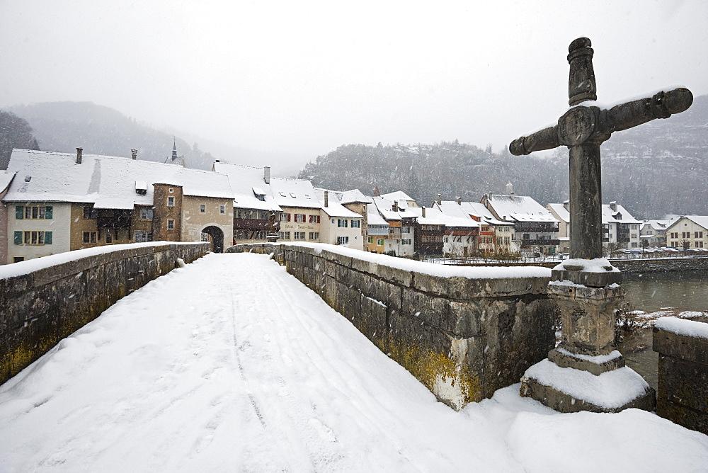 Snow covered town of St. Ursanne, Jura, Switzerland, Europe