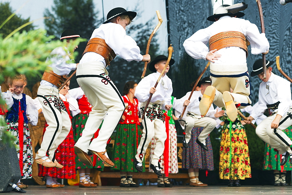 Performers in traditional costume, International Festival of Mountain Folklore, Zakopane, Carpathian Mountains, Poland, Europe