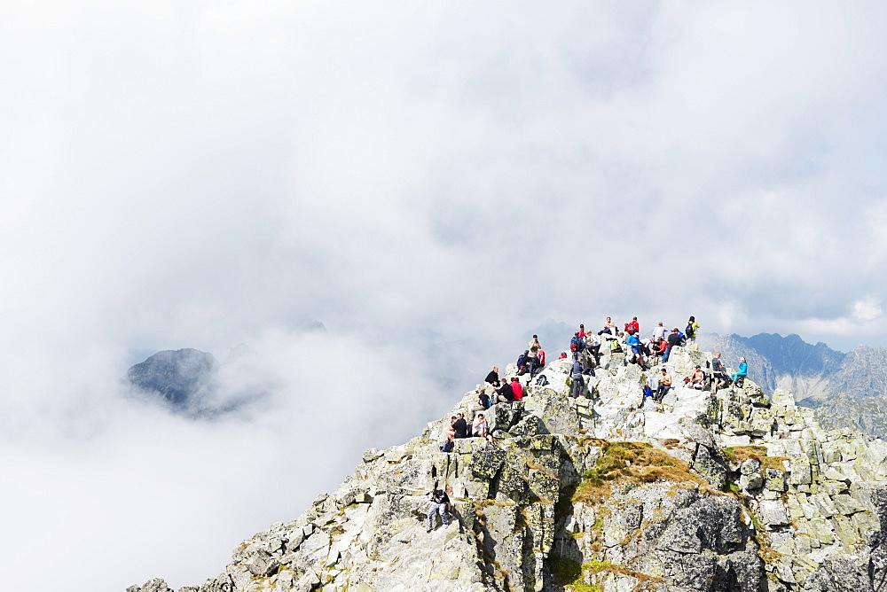 Hikers on summit of Mount Rysy, 2499m, the highest point in Poland, Zakopane, Carpathian Mountains, Poland, Europe