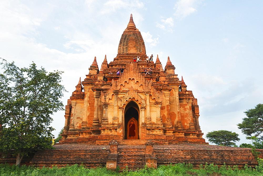 Tourists waiting for sunset on a temple, Bagan (Pagan), Myanmar (Burma), Asia