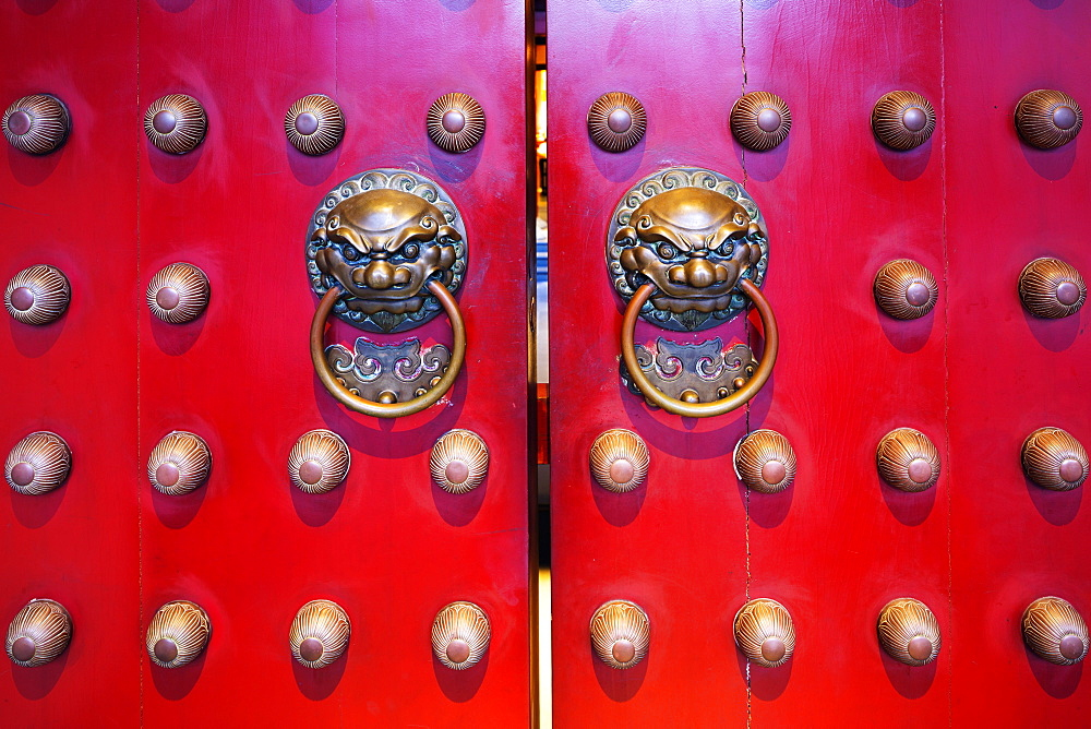 Dragon face door knockers, Buddha Tooth Relic temple, Chinatown, Singapore, Southeast Asia, Asia