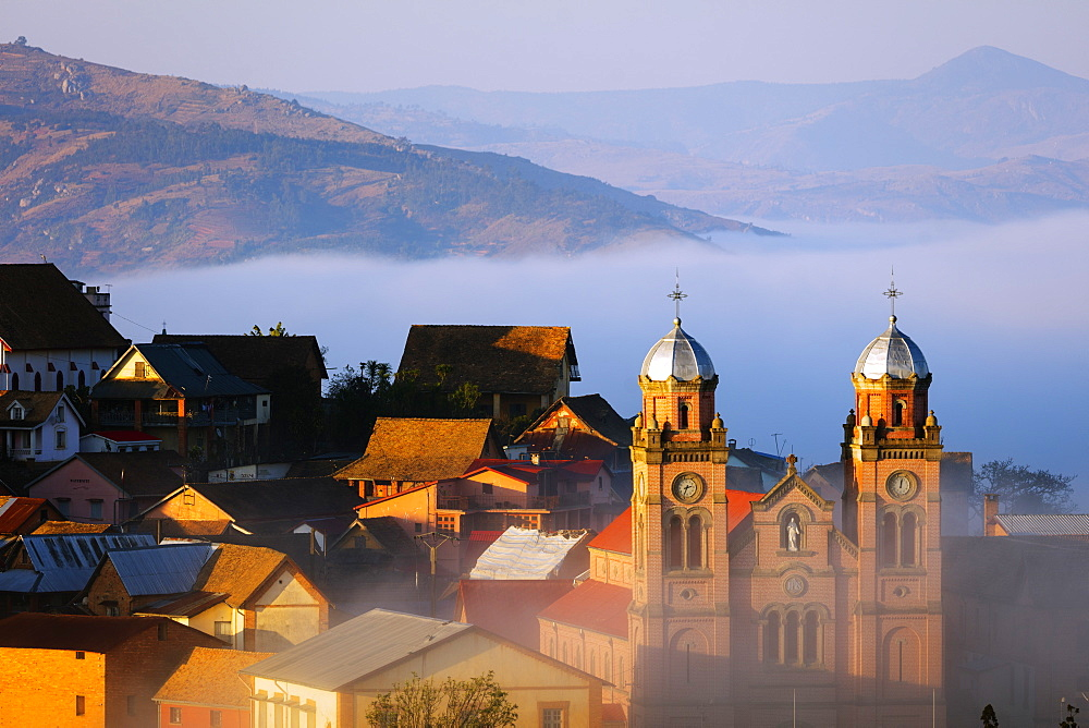 Early morning mist on the Haute Ville old town, Ambozontany Cathedral, Fianarantsoa, central area, Madagascar, Africa