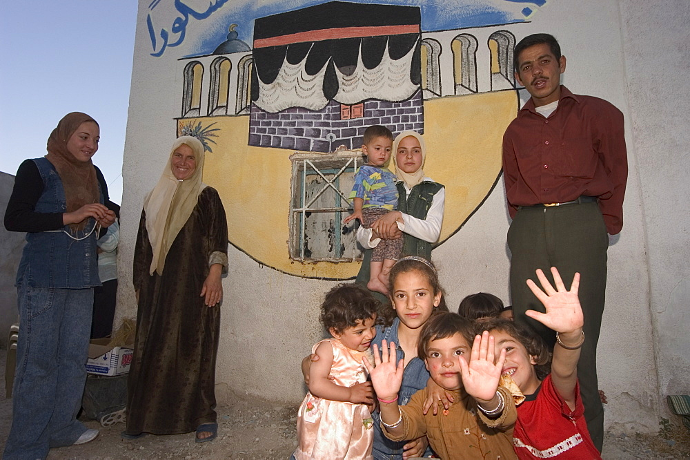 Local family with wall painting of Mecca, Apamea (Qalat at al-Mudiq), Syria, Middle East