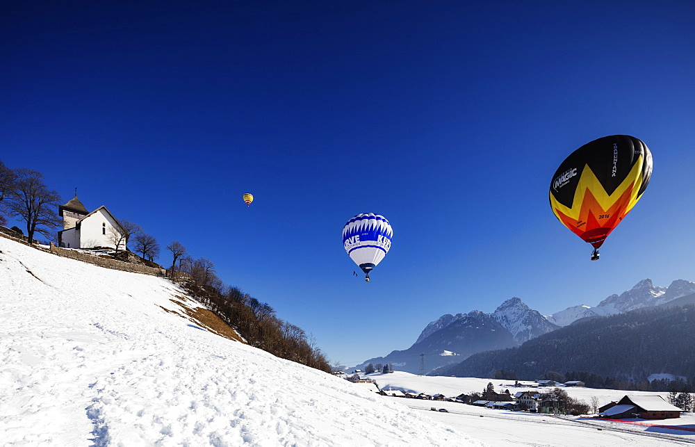 Europe, The Alps, Switzerland, Vaud, Château-d'Oex, International hot air balloon festival,