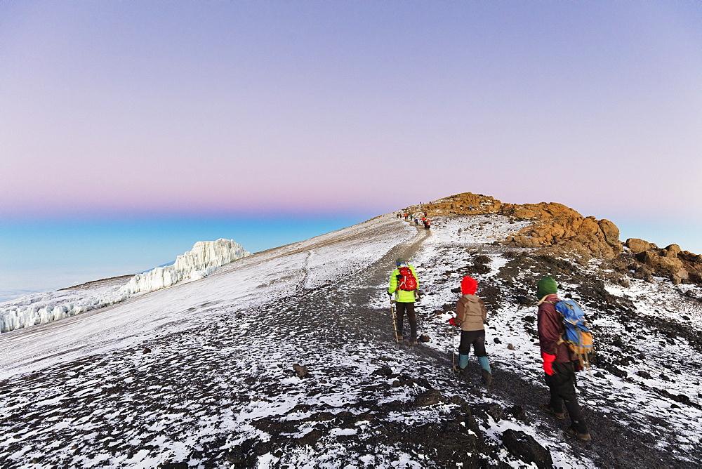 East Africa, Tanzania, Kilimanjaro National Park, Unesco, climbers near the summit and receding glacier of Kilimanjaro,