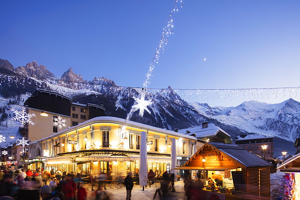 Christmas market decorations against backdrop of Mont Blanc mountain range, Chamonix, Haute Savoie, Rhone Alpes, France, Europe