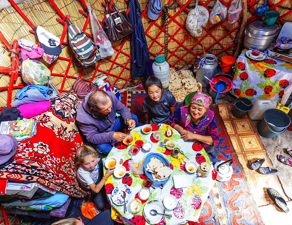 Local family in a yurt stay near Songkol lake, Kyrgyzstan, Central Asia, Asia - 733-8063