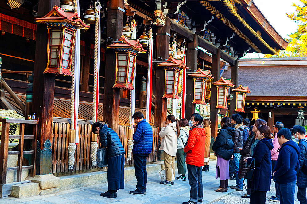 Worshippers at Kitano Tenmangu Shrine, Kyoto, Kansai, Japan, Asia