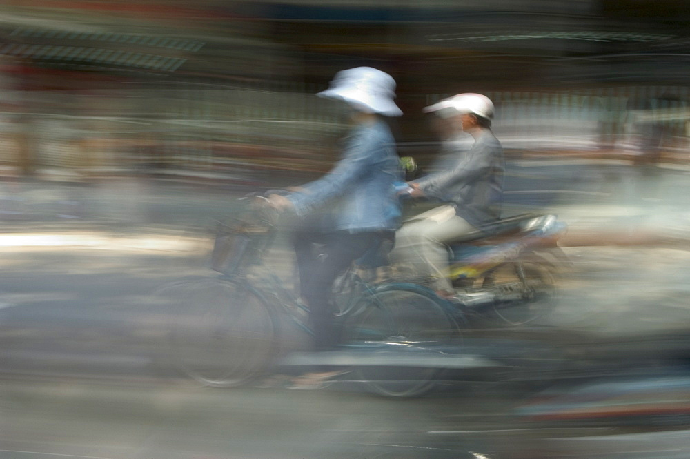 Motor bike and cyclist, Ho Chi Minh City (Saigon), Vietnam, Southeast Asia, Asia