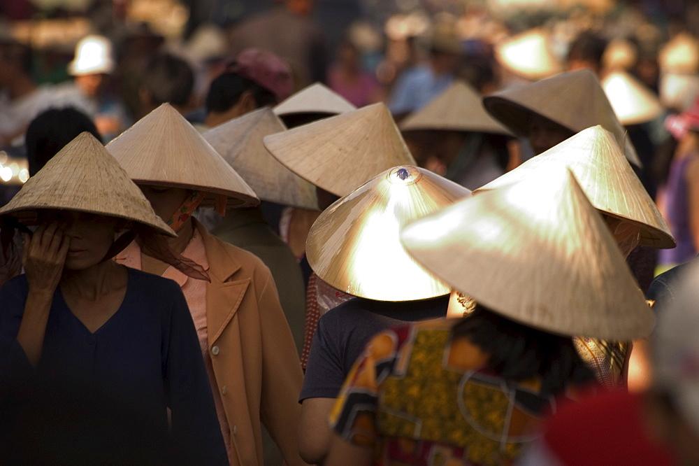 Women wearing conical hats, Binh Tay market, Ho Chi Minh City (Saigon), Vietnam, Southeast Asia, Asia