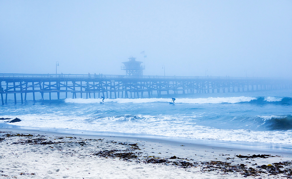 San Clemente pier with surfers on a foggy day, California, United States of America, North America - 734-151