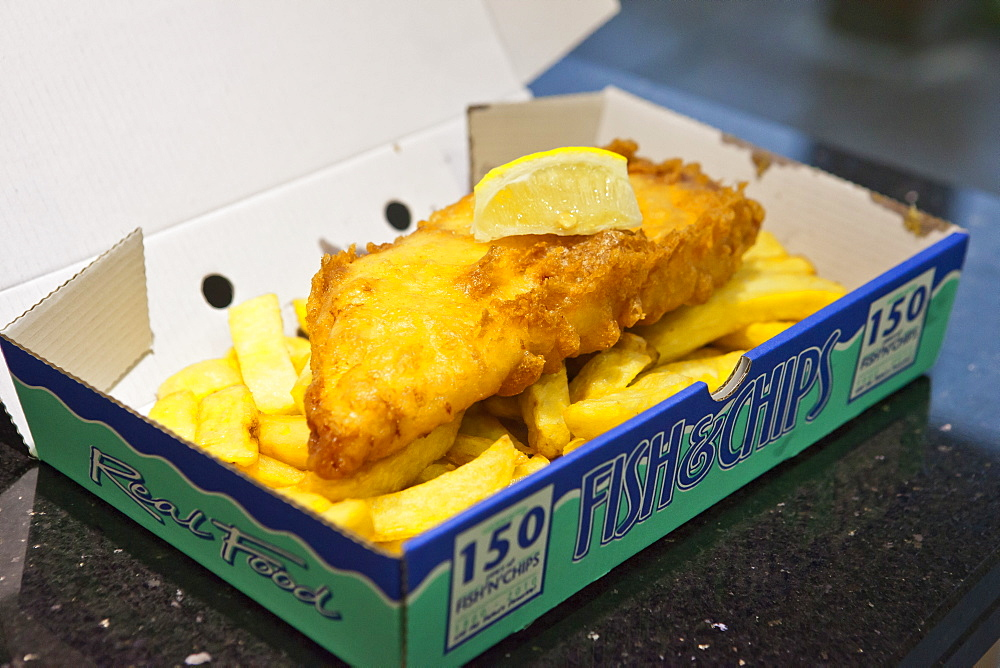 Traditional British fish and chips with slice of lemon, Gloucestershire, England, United Kingdom, Europe - 734-162
