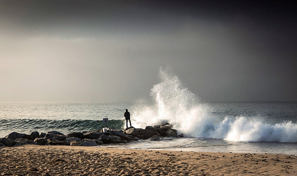 Early morning fisherman on Will Rogers Beach, Pacific Palisades. - 734-265