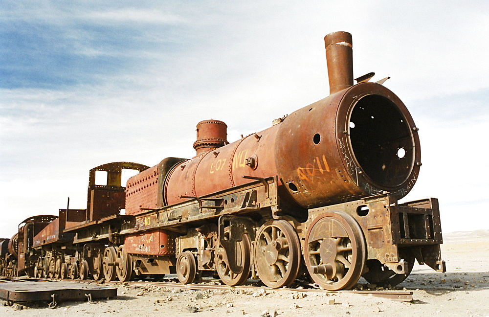 Rusting locomotive at train graveyard, Uyuni, Bolivia, South America