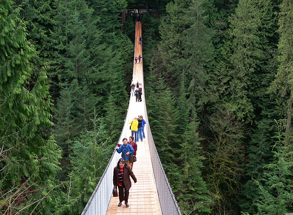 People walking across the Capilano Suspension Bridge, Vancouver, Canada