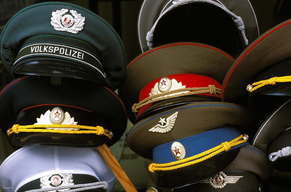 fd71eb877ea A pile of Communist era army and police hats for sale as souvenirs