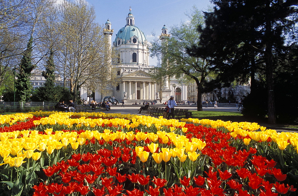 View over flowerbeds of red and yellow tulips to the Karlskirche (church), at Karlsplatz, Innere Stadt, Vienna, Austria, Europe
