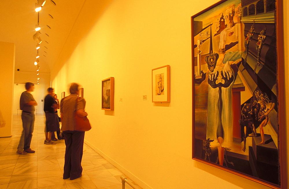 Visitors to the art gallery studying Salvador Dali's El Hombre Invisible (1930) in Museo Nacional Centro de Arte Reina Sofia, Retiro, Madrid, Spain, Europe
